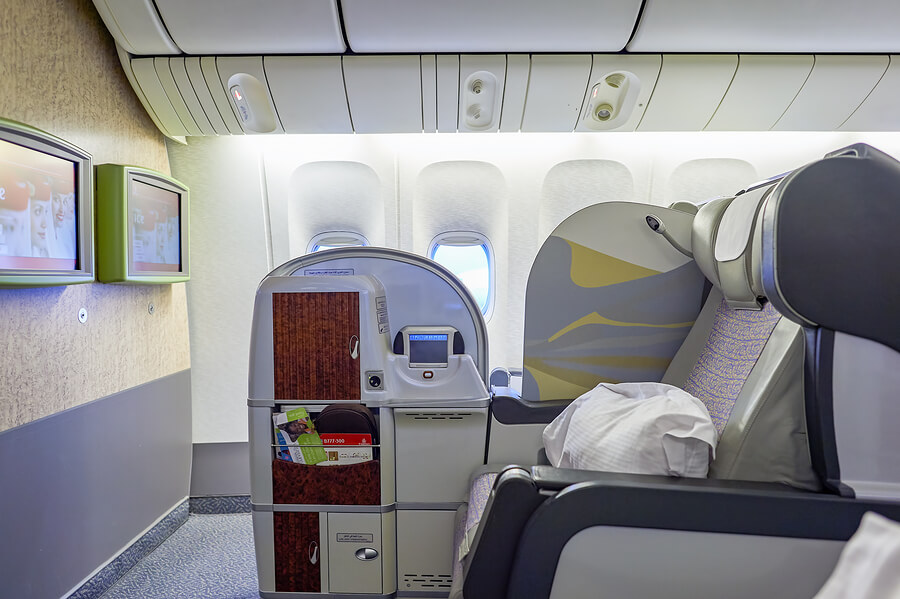 DUBAI, UAE - MARCH 30, 2015: inside of Emirates Boeing-777. Emirates is one of two flag carriers of the United Arab Emirates along with Etihad Airways and is based in Dubai.