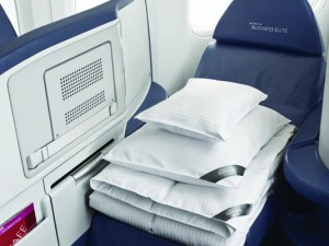 westin bedding on delta flight3 4 3 r536 c534 300x225 Airlines Offering more Amenities to go with those Flat Bed Seats