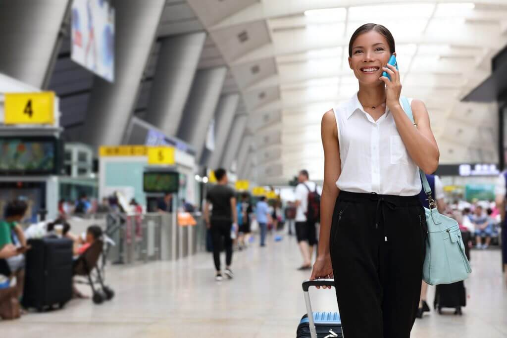 Businesswoman talking on the smartphone while walking.