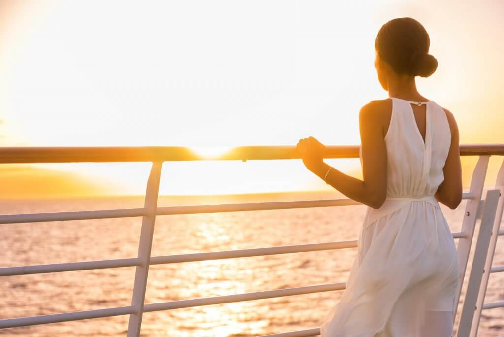 Woman on cruise ship looking out at the ocean