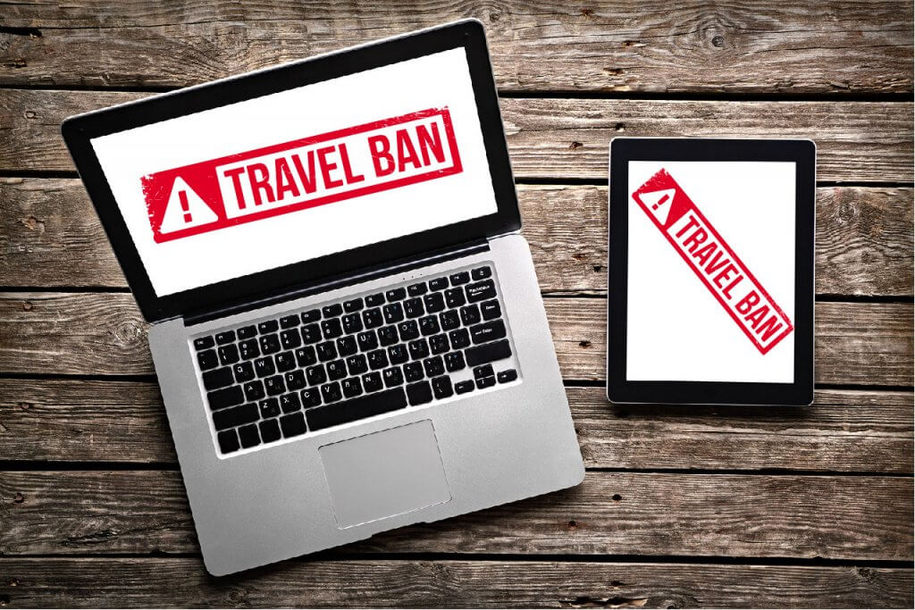 Travel ban showed on laptop and tablet