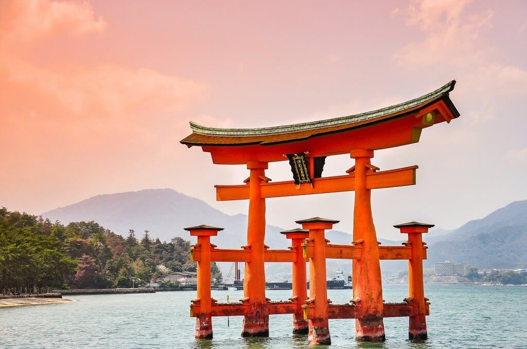 Miyajima Hiroshima Japan at the floating gate of Itsukushima Shrine. (gate sign reads Itsukushima Shrine)